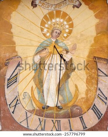 HALLSTATT, AUSTRIA - DECEMBER 13: Virgin Mary, sundial, painting on house facade on December 13, 2014 in Hallstatt, Austria. - stock photo