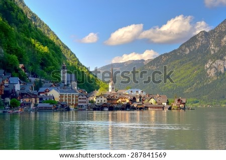 HALLSTATT, AUSTRIA - MAY 3, 2013: Hallstatt in Austria. Famous Hallstatt mountain village and alpine lake Hallstatter See, Austrian Alps. - stock photo