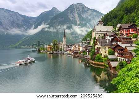 Hallstatt village in Alps at cloudy day, Austria - stock photo