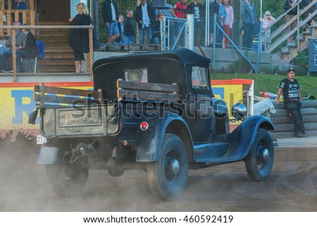 HALLSTAVIK, SWEDEN - JULY 19, 2016: Hotrod racerers in the pause between Rospiggarna and Lejonen at HZ Bygg Arena in Hallstavik.