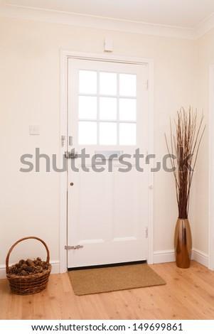 Hallway and front door - stock photo