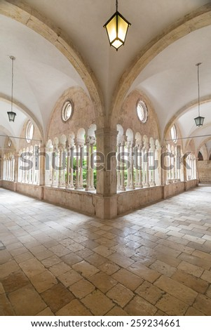 Hallway around famous courtyard in the Monastery of the Friars minor in Dubrovnik, Croatia. - stock photo