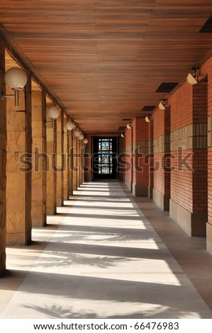 Hallway beside church Simple design aims to make the ceremony room. Cathedral Sacred Heart College.[covered way] Location Chiang Mai, Thailand. - stock photo