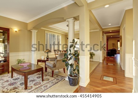 Hallway interior with columns. Rest area with old antique furniture, leather armchair and soft armchair