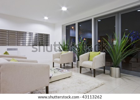 hallway of a modern development with post room and sofas - stock photo