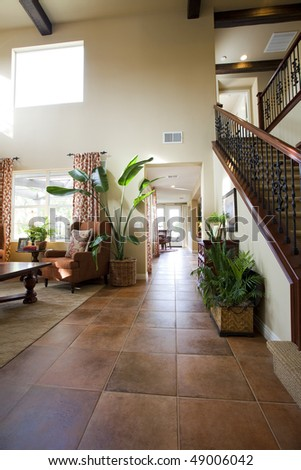 Hallway of luxury house with lots of natural light - stock photo