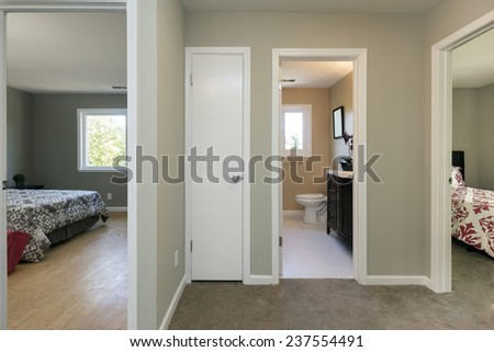 Hallway with adjacent bedrooms - stock photo