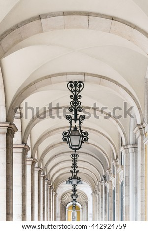 Hallway with columns surrounding the Commerce Square in Lisbon, Portugal - stock photo