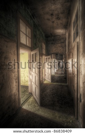 hallway with open doors in an abandoned asylum, hdr processing - stock photo