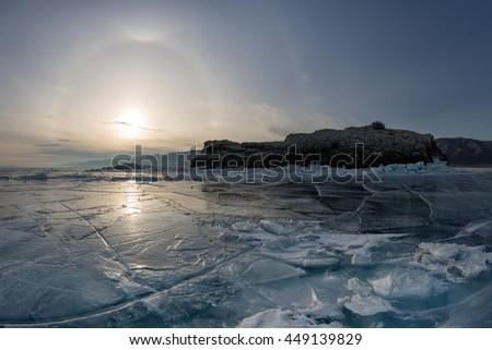 Halo Effect on frozen Lake Baikal. Elenka Island, Lake Baikal, Irkutsk region, Russia. - stock photo
