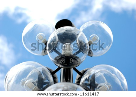 Halogen city streetlights with a beautiful clear blue sky behind them - stock photo