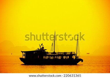 Halong Bay in sunset, Vietnam. Unesco World Heritage Site. Most popular place in Vietnam.  - stock photo