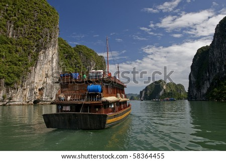 "Halong bay is a province in north Vietnam guangning bay, beautiful scenery, famous. Scenic area is divided into east, west, south three inlet. It is also called ""maritime guilin."""