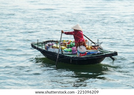 HALONG, VIETNAM - SEP 24 :Vendor woman selling fruit in Ha Long Bay, Vietnam. on Sep 24,2014. Ha Long Bay is a UNESCO World Heritage Site. - stock photo