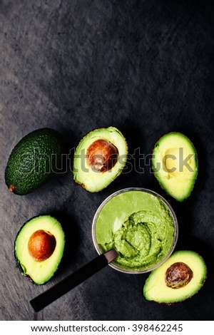 Halved avocados. Top view. Avocado spread. Avocado pasta. Guacamole - stock photo