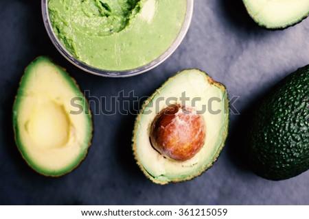 Halved avocados. Top view.  spread.  pasta. Guacamole  - stock photo