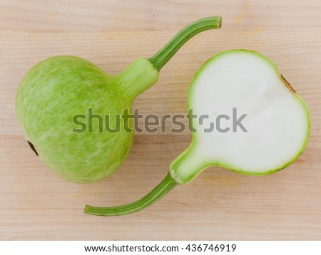 Halved bottle gourd or calabash gourd .The one of the vegetables recommended  in weight control programs. - stock photo
