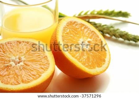 Halved orange with a glass of orange juice - stock photo