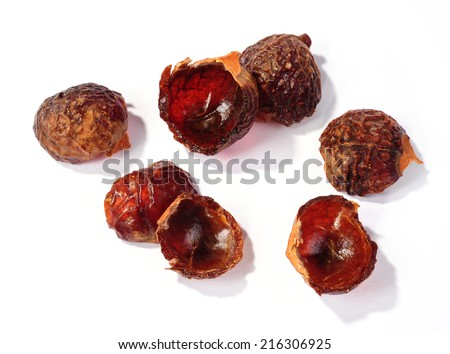 halved soap nuts shells isolated over white background