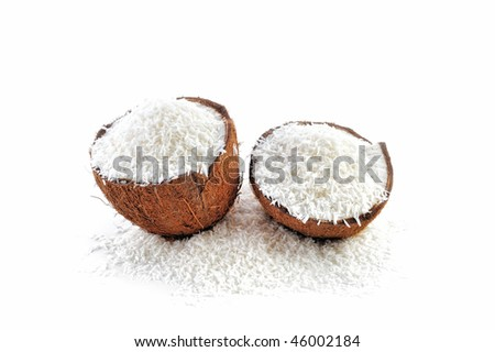 Halves of coconut parts is filled with crumbs - stock photo
