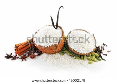 Halves of coconut parts is filled with crumbs and spice