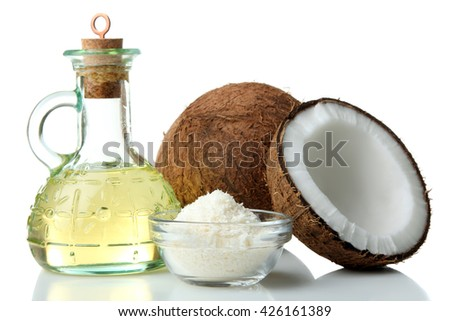 halves with coconut oil and coconut flakes in glass bowl on white isolated background - stock photo