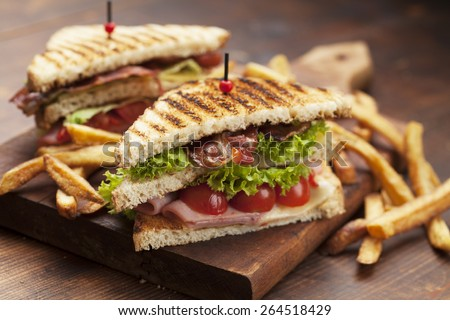 ham and bacon club sandwich on a white background - stock photo