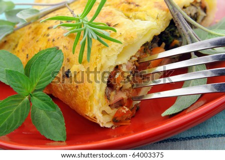 Ham and cheese pie with fresh herbs - stock photo