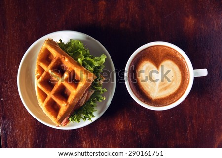 Ham and cheese sandwich served with hot coffee.on wooden table background - stock photo