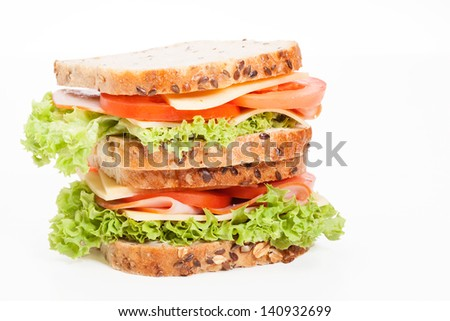 Ham and cheese sandwiches on plate - stock photo