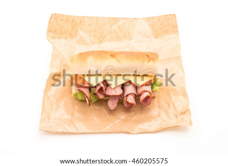 Ham and salad submarine sandwich on white background