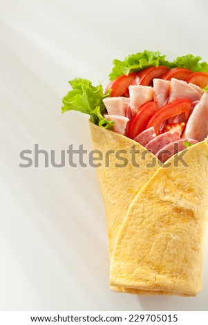 Ham and Salami Burrito with Vegetables and Salad Leaf - stock photo