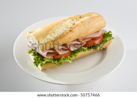 Ham and tomato sandwich on baguette - stock photo