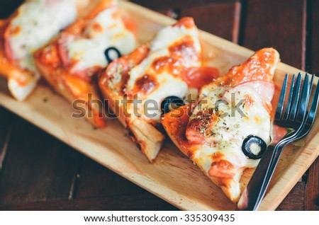 Ham cheese toast on wooden table in thailand - stock photo