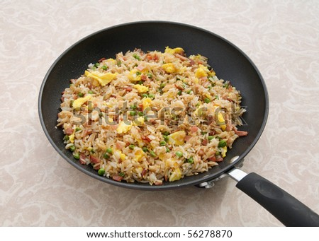 ham fried rice with egg in skillet close-up - stock photo