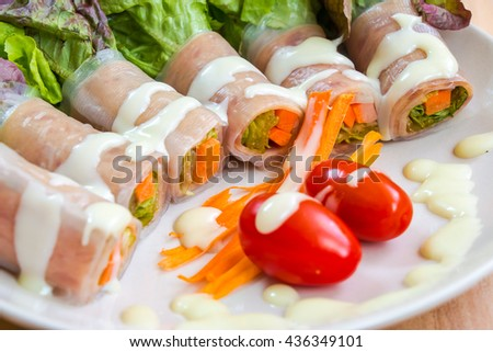 Ham roll salad with lettuce, tomato, egg and cream sauce, clean food and fresh vegetable. - stock photo