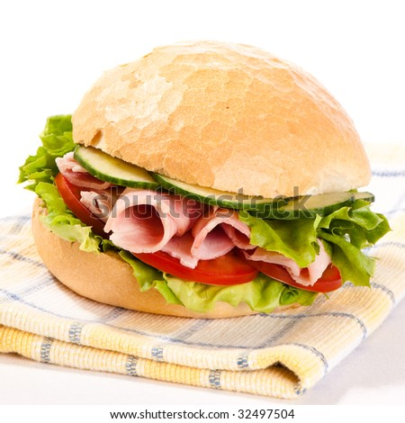 Ham salad crusty white roll on cloth with white background