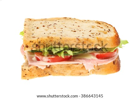Ham salad sandwich in multi-seeded brown bread isolated against white
