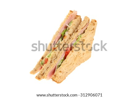 Ham salad sandwich made with multi grain bread isolated against white - stock photo