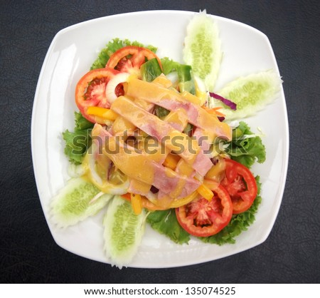 Ham Salad with vetgetable on white plate.