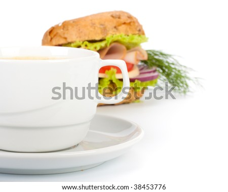 Ham sandwich and cup of coffee on a white background. Close up.