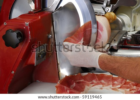Ham slicer and fresh ham slice. - stock photo