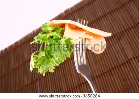 ham slices on fork with top slice folded - stock photo