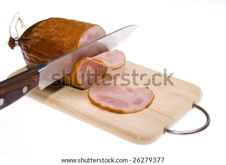 ham with knife on wooden cutting board - stock photo