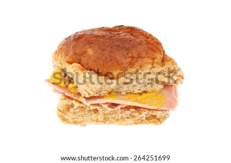 Ham with mustard in a wholemeal bread roll isolated against white - stock photo