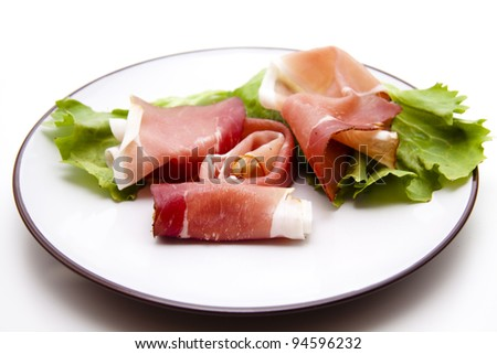 Ham with salad leaf on plate
