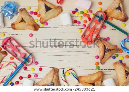 Hamantaschen cookies and candy background. View from above - stock photo