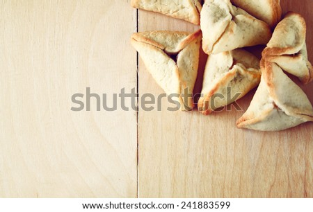 Hamantaschen cookies or hamans ears for Purim celebration (jewish holiday)  - stock photo