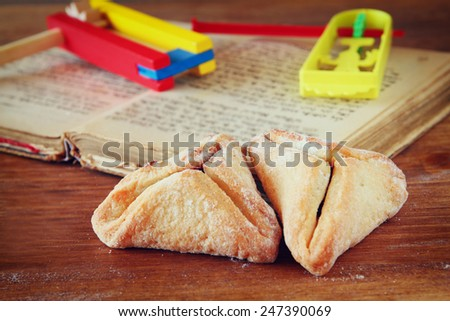 Hamantaschen cookies or hamans ears Purim celebration (jewish holiday). selective focus  - stock photo
