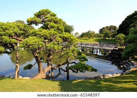 Hamarikyu Gardens is a public park in Chuo, Tokyo, Japan. Located at the mouth of the Sumida River, it was opened April 1, 1946. - stock photo